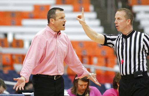 Louisville head coach Jeff Walz, left, yells at an official in the first quarter of an NCAA college basketball game against Syracuse in Syracuse, N.Y., Sunday, Feb. 4, 2018.