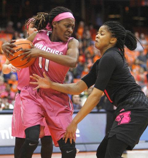 Louisville's Arica Carter, right, put pressure on Syracuse's Gabrielle Cooper, left, in the first quarter of an NCAA college basketball game in Syracuse, N.Y., Sunday, Feb. 4, 2018.