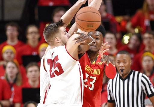 Maryland forward Bruno Fernando (23) passes the ball past Wisconsin forward Alex Illikainen (25) during the first half of an NCAA basketball game, Sunday, Feb. 4, 2018, in College Park, Md.