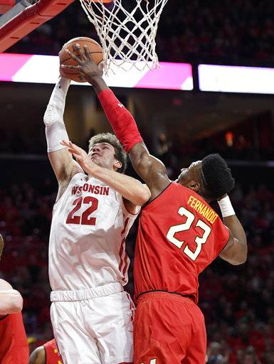 Maryland forward Bruno Fernando (23) blocks Wisconsin forward Ethan Happ (22) during the first half of an NCAA basketball game, Sunday, Feb. 4, 2018, in College Park, Md.