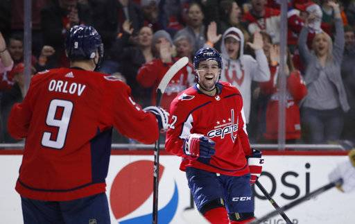 Washington Capitals defenseman Matt Niskanen, right, celebrates his goal with defenseman Dmitry Orlov (9), from Russia, in the second period of an NHL hockey game against the Vegas Golden Knights, Sunday, Feb. 4, 2018, in Washington.