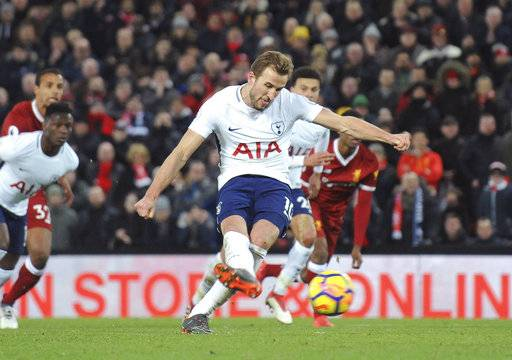 Tottenham's Harry Kane scores his side's second goal during the English Premier League soccer match between Liverpool and Tottenham Hotspur at Anfield in Liverpool, England, Sunday, Feb. 4, 2018.