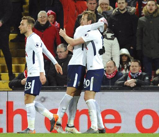 Tottenham's Harry Kane, right, celebrates after scoring his side's second goal during the English Premier League soccer match between Liverpool and Tottenham Hotspur at Anfield, Liverpool, England, Sunday, Feb. 4, 2018.
