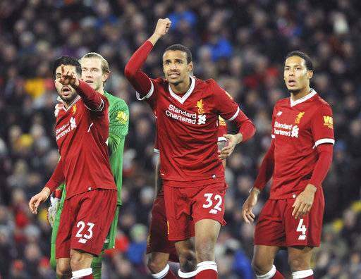 Liverpool's Emre Can, Loris Karius, Joel Matip, Virgil van Dijk, from left to right, react during the English Premier League soccer match between Liverpool and Tottenham Hotspur at Anfield, Liverpool, England, Sunday, Feb. 4, 2018.