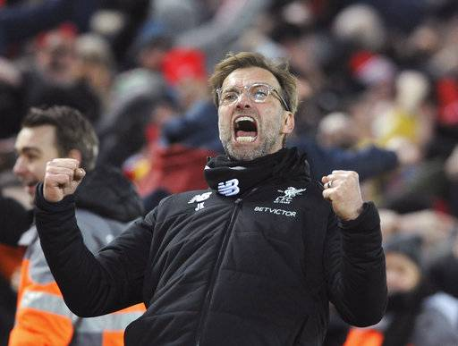 Liverpool manager Juergen Klopp celebrates after their second goal during the English Premier League soccer match between Liverpool and Tottenham Hotspur at Anfield in Liverpool, England, Sunday, Feb. 4, 2018.