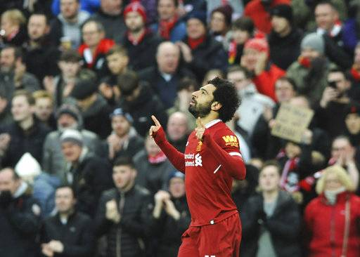 Liverpool's Mohamed Salah celebrates after scoring his side's first goal during the English Premier League soccer match between Liverpool and Tottenham Hotspur at Anfield in Liverpool, England, Sunday, Feb. 4, 2018.