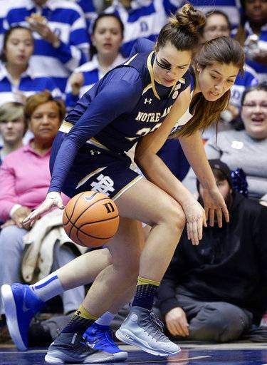 Notre Dame's Kathryn Westbeld, front, and Duke's Bego Faz Davalos struggle for possession of the ball during the first half of an NCAA college basketball game in Durham, N.C., Sunday, Feb. 4, 2018.