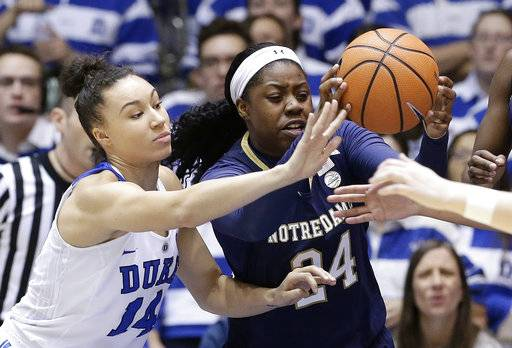 Notre Dame's Arike Ogunbowale (24) and Duke's Faith Suggs (14) chase the ball during the first half of an NCAA college basketball game in Durham, N.C., Sunday, Feb. 4, 2018.
