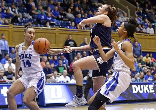 Notre Dame's Marina Mabrey drives to the basket while Duke's Faith Suggs (14) and Leaonna Odom defend during the first half of an NCAA college basketball game in Durham, N.C., Sunday, Feb. 4, 2018.