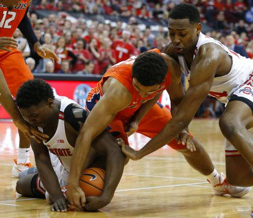 Illinois' Mark Smith, center, fights for the ball against Ohio State's Jae'Sean Tate, left, and Andre Wesson during the first half of an NCAA college basketball game Sunday, Feb. 4, 2018, in Columbus, Ohio.