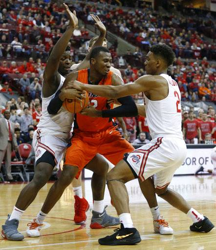 Illinois' Leron Black, center, tries to keep the ball away from Ohio State's Jae'Sean Tate, left, and Musa Jallow during the first half of an NCAA college basketball game Sunday, Feb. 4, 2018, in Columbus, Ohio.