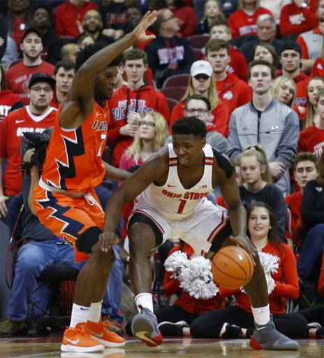 Ohio State's Jae'Sean Tate, right, posts up against Illinois' Kipper Nichols during the first half of an NCAA college basketball game Sunday, Feb. 4, 2018, in Columbus, Ohio.