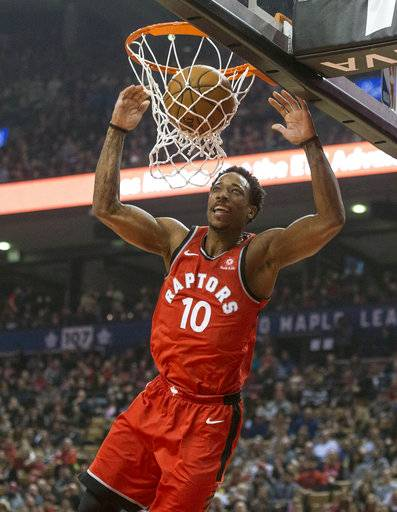 Toronto Raptors guard DeMar DeRozan (10) dunks during first-half NBA basketball game action against the Memphis Grizzlies in Toronto, Sunday, Feb. 4, 2018. (Chris Young/The Canadian Press via AP)