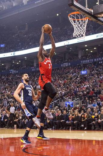 Toronto Raptors forward OG Anunoby (3) scores against Memphis Grizzlies center Marc Gasol (33) during first-half NBA basketball game action in Toronto, Sunday, Feb. 4, 2018. (Chris Young/The Canadian Press via AP)