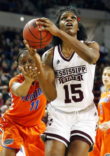 Mississippi State center Teaira McCowan (15) tries to shoot as Florida guard Dyandria Anderson (11) reaches in to block during the first half of the NCAA college basketball game in Starkville, Miss., Thursday, Jan. 25, 2018.