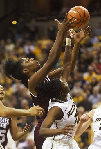 Mississippi State's Teaira McCowan, left, pulls down a rebound over Missouri's Amber Smith, right, during the second half of an NCAA college basketball game Thursday, Feb. 1, 2018, in Columbia, Mo. Mississippi State won the game 57-53.