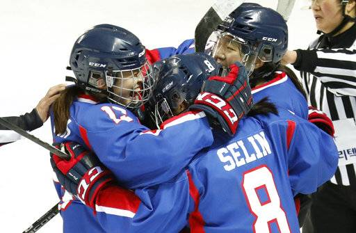 Combined Koreas players celebrate after scoring against Sweden during their women's ice hockey friendly game at Seonhak International Ice Rink in Incheon, South Korea, Sunday, Feb. 4, 2018. (Kim Hong-Ji/Pool Photo via AP)