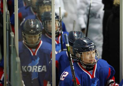 Inter-Korea's players walk into the ice, during the women's hockey friendly game between Koreas' combined team and Sweden, at Seonhak International Ice Rink in Incheon, South Korea, Sunday, Feb. 4, 2018. (Kim Hong-Ji/Pool Photo via AP)