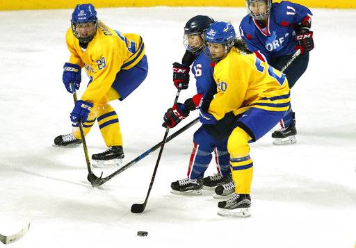 Combined Koreas' Ryo Song Hui (16) and Sweden's Fanny Rask, right, during their women's ice hockey friendly game at Seonhak International Ice Rink in Incheon, South Korea, Sunday, Feb. 4, 2018. (Kim Hong-Ji/Pool Photo via AP)