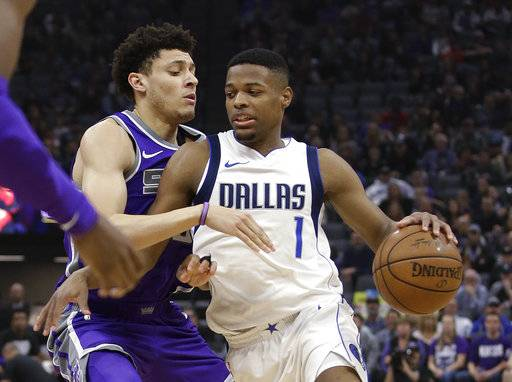 Dallas Mavericks guard Dennis Smith Jr., right, drives against Sacramento Kings forward Justin Jackson during the first quarter of an NBA basketball game Saturday, Feb. 3, 2018, in Sacramento, Calif.