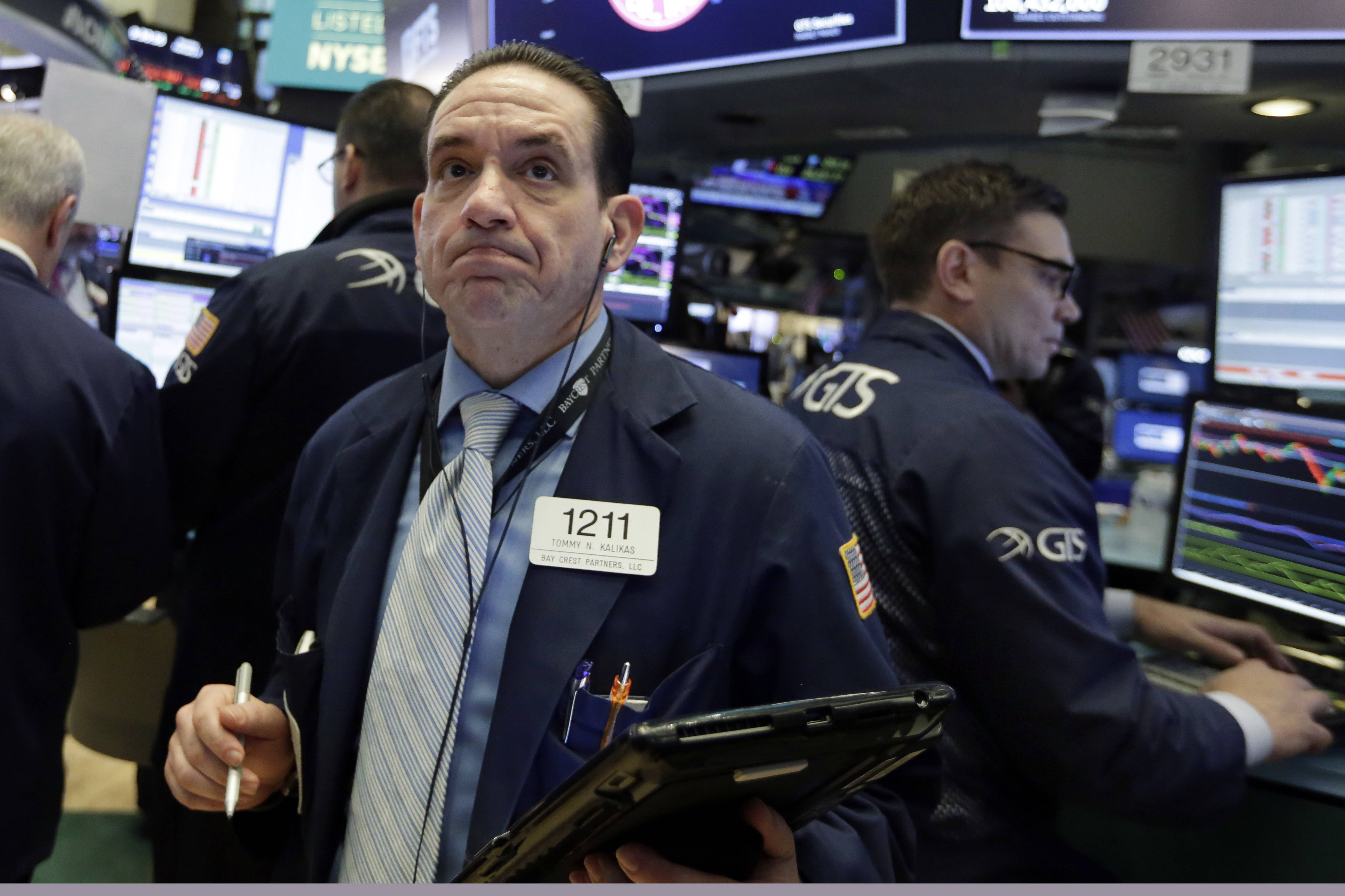Trader Tommy Kalikas works Monday on the floor of the New York Stock Exchange. Stock markets around the world took another pummeling Monday as investors continued to fret over rising U.S. bond yields.
