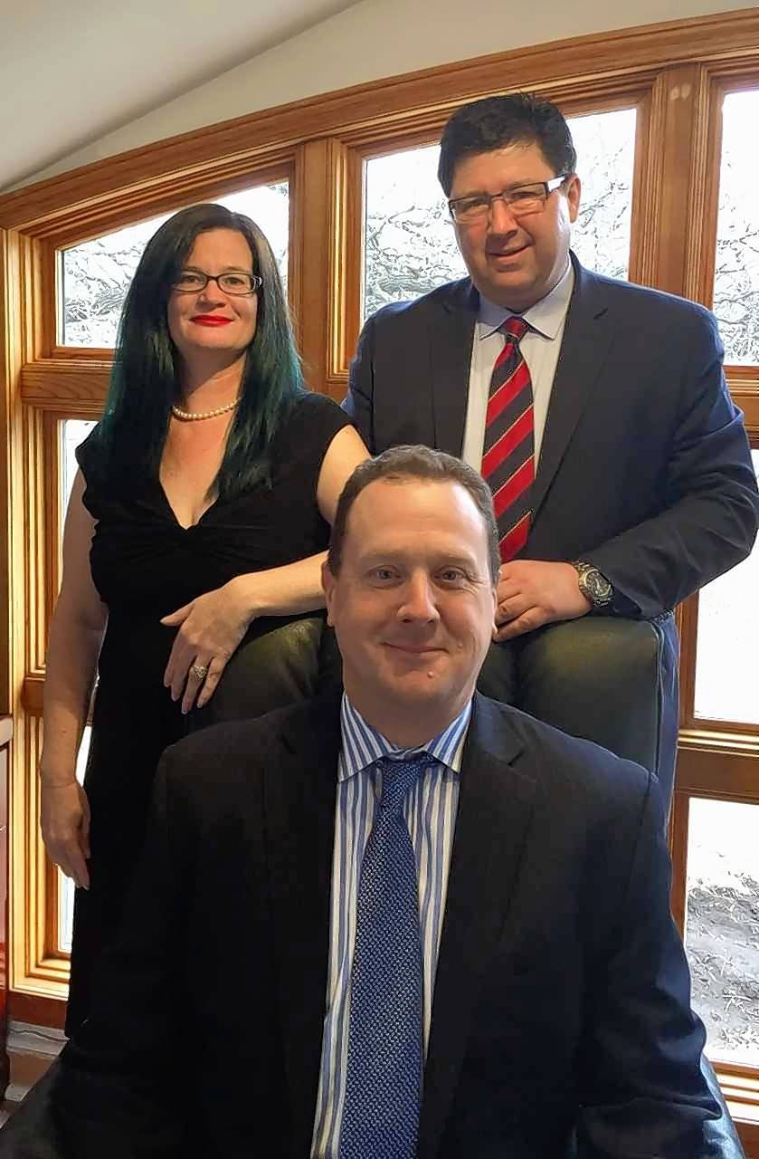 Metz, Gilmore & Vaclavek LLC in Crystal Lake acquired a law firm. Included in the practice are Carl E. Metz II, seated, and Kelly Vaclavek and Carl Gilmore.
