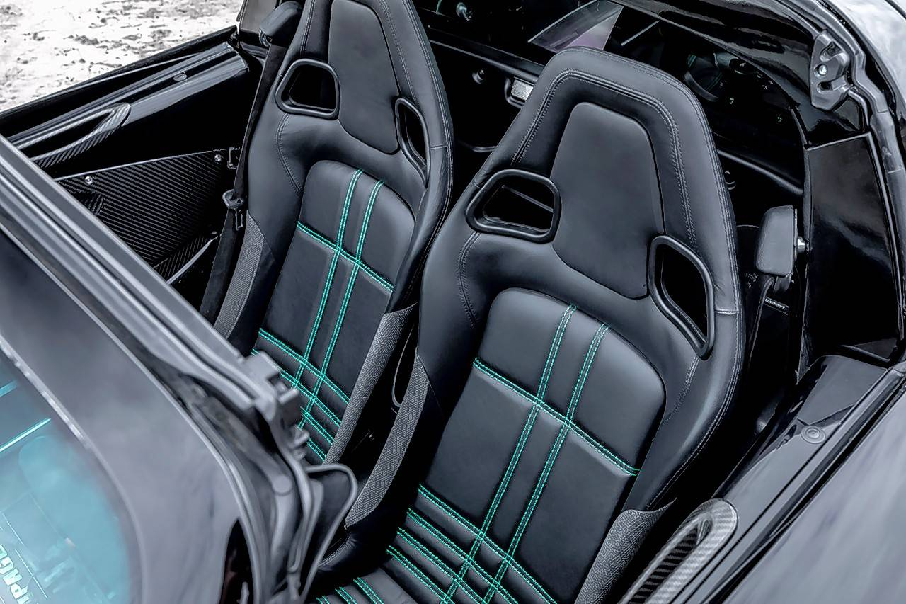The interior features carbon fiber details, leather seats and an Alcantara sport steering wheel.