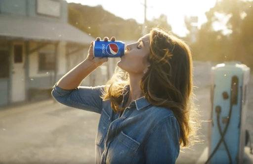 This photo provided by PepsiCo shows Cindy Crawford in a scene from the company's Pepsi Super Bowl spot. For the 2018 Super Bowl, marketers are paying more than $5 million per 30-second spot to capture the attention of more than 110 million viewers. (PepsiCo via AP)