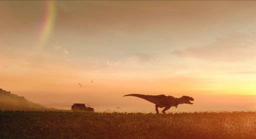 "This photo provided by Jeep Brand/Universal Pictures shows a scene from Jeep Brand's ""Jeep Jurassic"" Super Bowl spot. For the 2018 Super Bowl, marketers are paying more than $5 million per 30-second spot to capture the attention of more than 110 million viewers. (Jeep Brand/Universal Pictures via AP)"
