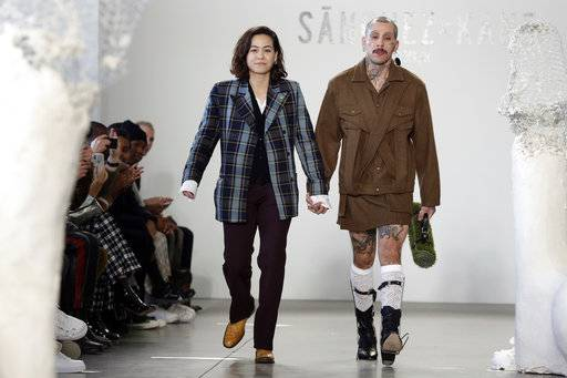 Designer Barbara Sanchez-Kane, left, walks the runway with one of her models after her Fall 2018 collection was modeled during Fashion Week in New York, Monday, Feb. 5, 2018.