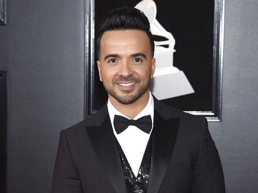 "FILe - In this Jan. 28, 2018 file photo, Luis Fonsi arrives at the 60th annual Grammy Awards in New York. The annual BMI Latin Awards will honor Fonsi not only for his mega smash ""Despacito� but for the string of hits he's racked up over two decades. Fonsi is set to receive the BMI President's Award at the March 20 ceremony in Beverly Hills, Calif.  (Photo by Evan Agostini/Invision/AP, File)"