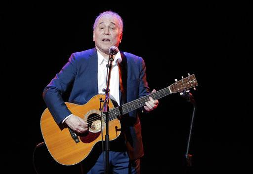 FILE - In a Sept. 22, 2016 file photo, musician Paul Simon performs during the Global Citizen Festival, in New York. On Monday, Feb. 5, 2018, Simon took to social media to say his upcoming tour will be his last, citing the personal toll of touring and the death of his lead guitarist, Vincent N'guini.