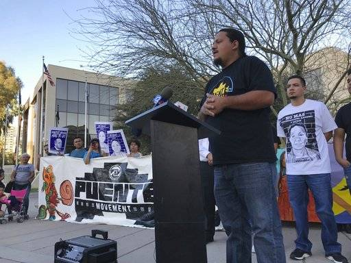 Carlos Garcia, executive director of the immigrant advocate group Puente, addresses a rally of some 40 people outside the U.S. Immigration and Customs Enforcement building in Phoenix, Monday, Feb. 5, 2018. A year ago, immigrant mother Guadalupe Garcia de Rayos was arrested and deported back to her native Mexico. Her case became a cause celebre for advocates who say President Donald Trump's immigration policies hurt families. Her attorney is seeking to reopen her case for using a fraudulent ID to get a job, a conviction that made her vulnerable to deportation under Trump after enjoying leniency during the Obama administration.