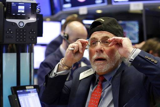 Trader Peter Tuchman works on the floor of the New York Stock Exchange, Monday, Feb. 5, 2018. The Dow Jones industrial average plunged more than 1,100 points Monday as stocks took their worst loss in six and a half years.