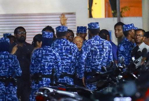 Policemen arrest former Maldives president and opposition leader Maumoon Abdul Gayoom, center, after the government declared a 15-day state of emergency in Male, Maldives, early Tuesday, Feb. 6, 2018. The Maldives government declared a 15-day state of emergency Monday as the political crisis deepened in the Indian Ocean nation amid an increasingly bitter standoff between the president and the Supreme Court. Hours after the emergency was declared, soldiers forced their way into the Supreme Court building, where the judges were believed to be taking shelter, said Ahmed Maloof, an opposition member of Parliament.