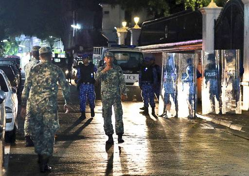 Maldives defence soldiers patrol on the main street of Male, Maldives, Monday, Feb. 5, 2018. The Maldives government has declared a 15-day state of emergency as the political crisis deepens in the Indian Ocean nation amid an increasingly bitter standoff between the president and the Supreme Court.
