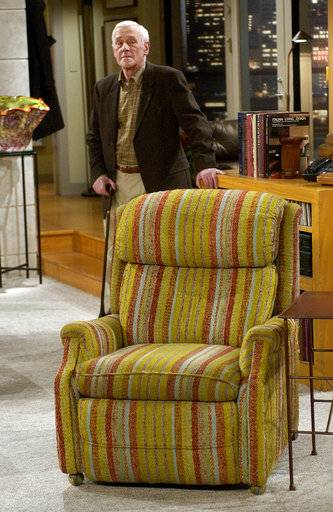 "FILE - In this March 23, 2004 file photo, John Mahoney, who stars as Martin Crane, appears on the set during the filming of the final episode of ""Frasier"" in Los Angeles. Mahoney's longtime manager, Paul Martino, said Mahoney died Sunday, Feb. 4, 2018, in Chicago after a brief hospitalization. The cause of death was not immediately announced. He was 77."