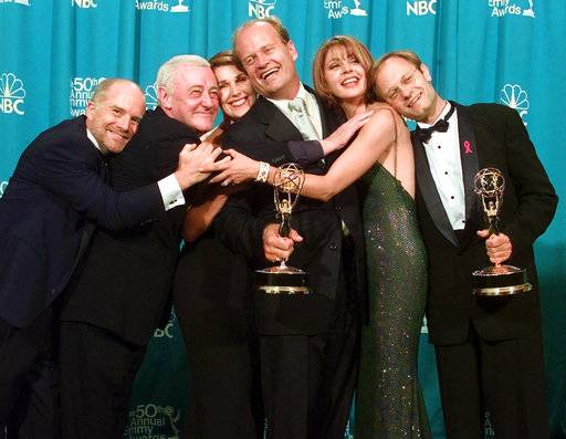 "FILE - In this Sept. 13, 1998 file photo, cast members of ""Frasier,"" from left, Dan Butler, John Mahoney, Peri Gilpin, Kelsey Grammer, Jane Leeves and David Hyde Pierce, winners of the Emmy for Outstanding Comedy Series, pose backstage at the 50th Annual Primetime Emmy Awards in Los Angeles. Mahoney's longtime manager, Paul Martino, said Mahoney died Sunday, Feb. 4, 2018, in Chicago after a brief hospitalization. The cause of death was not immediately announced. He was 77."