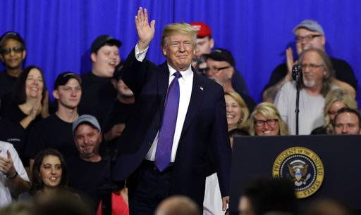 President Donald Trump waves after speaking on tax policy during a visit to Sheffer Corporation, Monday, Feb. 5, 2018, in Blue Ash, Ohio.