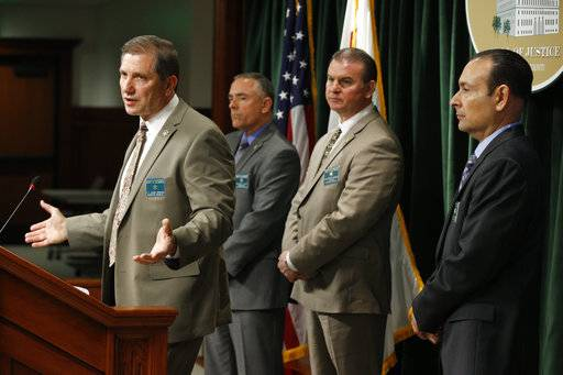 Los Angeles County Sheriff's Department Homicide Bureau Lt. John Corina, far left, discusses the most recent details of the Natalie Wood death investigation at a news conference in Los Angeles, Monday, Feb. 5, 2018. Officials, seen behind from left, Comdr. Steve Katz, Capt. Christopher Bergner and detective Ralph Hernandez. There's renewed interest in the decades-old death of  Wood, with the lead detective in the case saying her widower, actor Robert Wagner, now 87, is considered a person of interest.