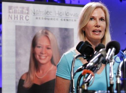 "FILE - In this June 8, 2010, file photo, Beth Holloway, mother of Natalee Holloway, speaks during the opening of the Natalee Holloway Resource Center (NHRC) at the National Museum of Crime & Punishment in Washington. Beth Holloway claims in the federal lawsuit filed Friday, Feb. 2, 2018, that the deception surrounding ""The Disappearance of Natalee Holloway"" was so complete she was even tricked her into providing a DNA sample to match against what producers claimed were remains that could be those of her long-missing daughter."