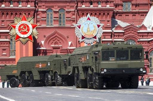 "FILE - In this Saturday, May 9, 2015 file photo, Iskander missile launchers are driven during the Victory Parade marking the 70th anniversary of the defeat of the Nazis in World War II, in Red Square in Moscow. Lithuania's president says Russia has deployed additional nuclear-capable missiles in its Baltic Sea exclave of Kaliningrad on a permanent basis, calling it a threat to Europe. Dalia Grybauskaite told reporters Monday, Feb. 5, 2018 after visiting NATO troops in the town of Rukla that ""Iskander missiles are being stationed in Kaliningrad for permanent presence as we speak."""