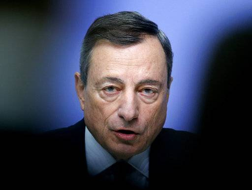 FILE - In this Thursday, Dec. 14, 2017 file photo, President of the European Central Bank Mario Draghi speaks during a news conference in Frankfurt, Germany. Draghi says it's too soon to declare victory over weak inflation - indicating it's too early to set a definite end date for the bank's money-printing stimulus despite a strengthening economy.