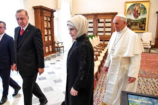 Turkish President Recep Tayyip Erdogan, left, and his wife Emine, center, meet Pope Francis at the Vatican, Monday, Feb. 5, 2018. Erdogan is the first Turkish president to visit the Vatican in nearly six decades. Francis met with him during his 2014 trip to Istanbul. (Alessandro Di Meo/Pool photo via AP)