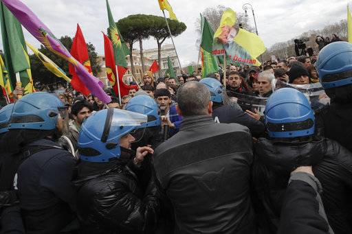 Italian policemen face pro-Kurdish demonstrators during a sit-in near the Vatican in Rome, Monday, Feb. 5, 2018. Some 150 pro-Kurdish protesters gathered near the Vatican on Monday as Turkish President Recip Tayyip Erdogan swept past in a long motorcade to the Vatican where he met with Pope Francis.
