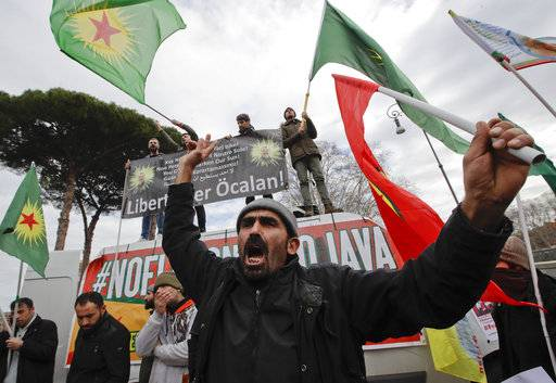 A man holding a Turkish Workers' Party (PKK) flag shouts slogans during a sit-in near the Vatican in Rome, Monday, Feb. 5, 2018. Some 150 Kurdish protesters gathered near the Vatican on Monday as Turkish President Recip Tayyip Erdogan swept past in a long motorcade to the Vatican where he met with Pope Francis.