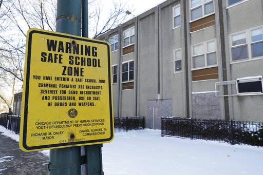 In this Jan. 18, 2018, photo, a safe school zone sign still hangs at the closed Arna Wendell Bontemps Elementary School in the Englewood neighborhood of Chicago. Five years after the nation's largest mass closure of public schools, Chicago is forging ahead with plans to shutter four more in one of the city's highest-crime and impoverished areas while school officials are pitching the new closures in Englewood to make way for a new $85 million school they insist will better serve students and reverse low enrollment.