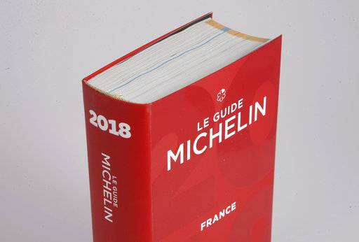 The Michelin Guide 2018 is pictured in Boulogne-Billancourt, outside Paris, France, Monday, Feb. 5, 2018. A record 28 French restaurants were honored with the gastronomic world's most coveted prize Monday: a three-star Michelin rating.