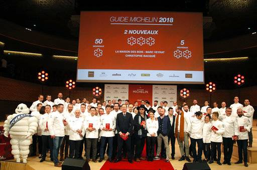 One, two and three-star chefs pose during the Michelin Guide ceremony in Boulogne-Billancourt, outside Paris, France, Monday, Feb. 5, 2018. A record 28 French restaurants were honored with the gastronomic world's most coveted prize Monday: a three-star Michelin rating.