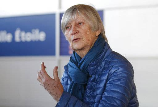 Catherine Bonnet, French child psychiatrist and a member of the Pontifical Commission for the Protection of Minors, gestures as she speaks during an interview with the Associated Press at Charles de Gaulle airport outside Paris, France, Sunday, Feb. 4, 2018. Commission members and a church sex-abuse victim say Pope Francis received a letter from the victim in 2015 that graphically detailed his abuse and a cover-up by Chilean church authorities, contradicting the pope's recent insistence that no victims had come forward.
